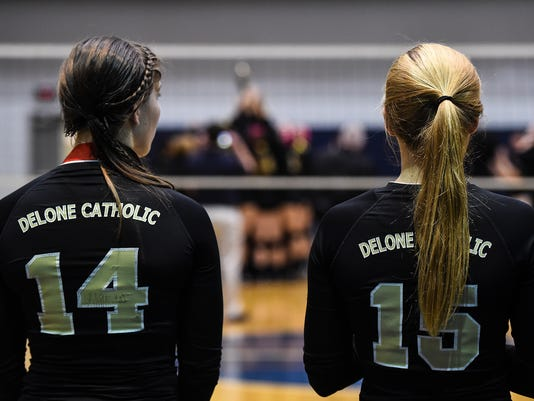 Delone's Maddie Comly, left, and Emma Malinowski watch as Berks Catholic players lift the championship trophy on Saturday Nov. 1, 2014 after Delone lost 3-1 to Berks Catholic in the District III Class AA volleyball championship at Dallastown Senior High School.  Shane Dunlap - GameTimePA
