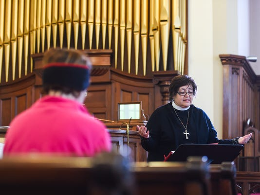 Rev. Grace Gravelle conducts a prayer service Tuesday morning in response to Monday's riots in Baltimore at Christ Lutheran Church in Shrewsbury.