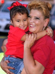 Ruby Marie Luera, 3, dances with her mother Josie Luera during Friday night's free concert at Peppers Supermarket.