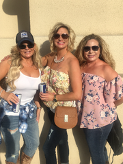 Angela Goffinet, center, and friends Tiffany Montes, left, and Denise LoForti, right, pose outside the Mandalay Bay resort and casino on Friday, Sept. 29, 2017.