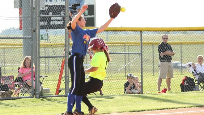 Munford's Maddison Welch is safe on a steal in front of Riverside's Bree Linton. Linton was named game MVP.