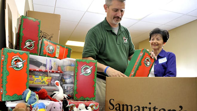 Samaritan's Purse Operation Christmas Child project collects colorfully wrapped shoe boxes with gifts inside for needy children.