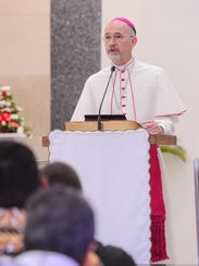 Archbishop Martin Krebs speaks during a prayer gathering