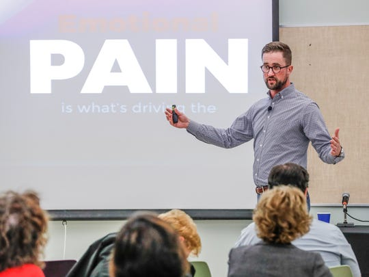 Austin Eubanks, a survivor of the Columbine school shooting speaks about addiction resulting from trauma during the the 11th Annual Susan Li Conference at Hope Academy Recovery High School in Indianapolis on Thursday, July 19, 2018.
