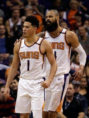 Phoenix Suns guard Devin Booker (1) gets held back by Tyson Chandler after getting called for a technical foul against the Indiana Pacers in the second half during an NBA basketball game, Sunday, Jan. 14, 2018, in Phoenix. The Pacers defeated the Suns 120-97.