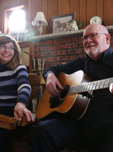 From left, Carol and Kevin Becker play a song at their home in Hyde Park on Jan. 3, 2017. Kevin Becker co-founded the Hudson Valley Folk Guild in 1979.