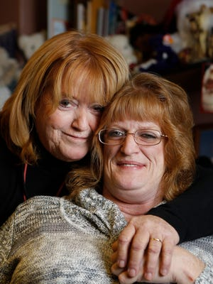 Dixie Sucher, left,with her daughter, Kelly Chambers, now 46, who has been living with HIV for about 25 years and AIDS for 20.