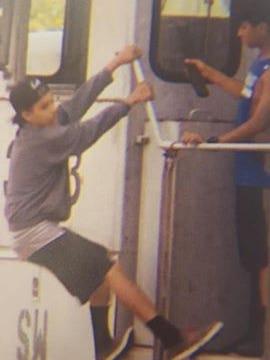 Children vandalizing a train.
