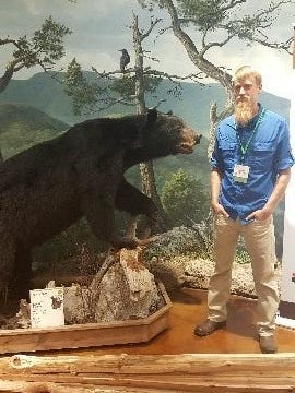 Timothy P. Justnes with his state record bear