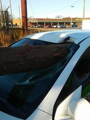 A log punched through the windshield of a car Tuesday morning on S.C. 28 Bypass in Anderson.