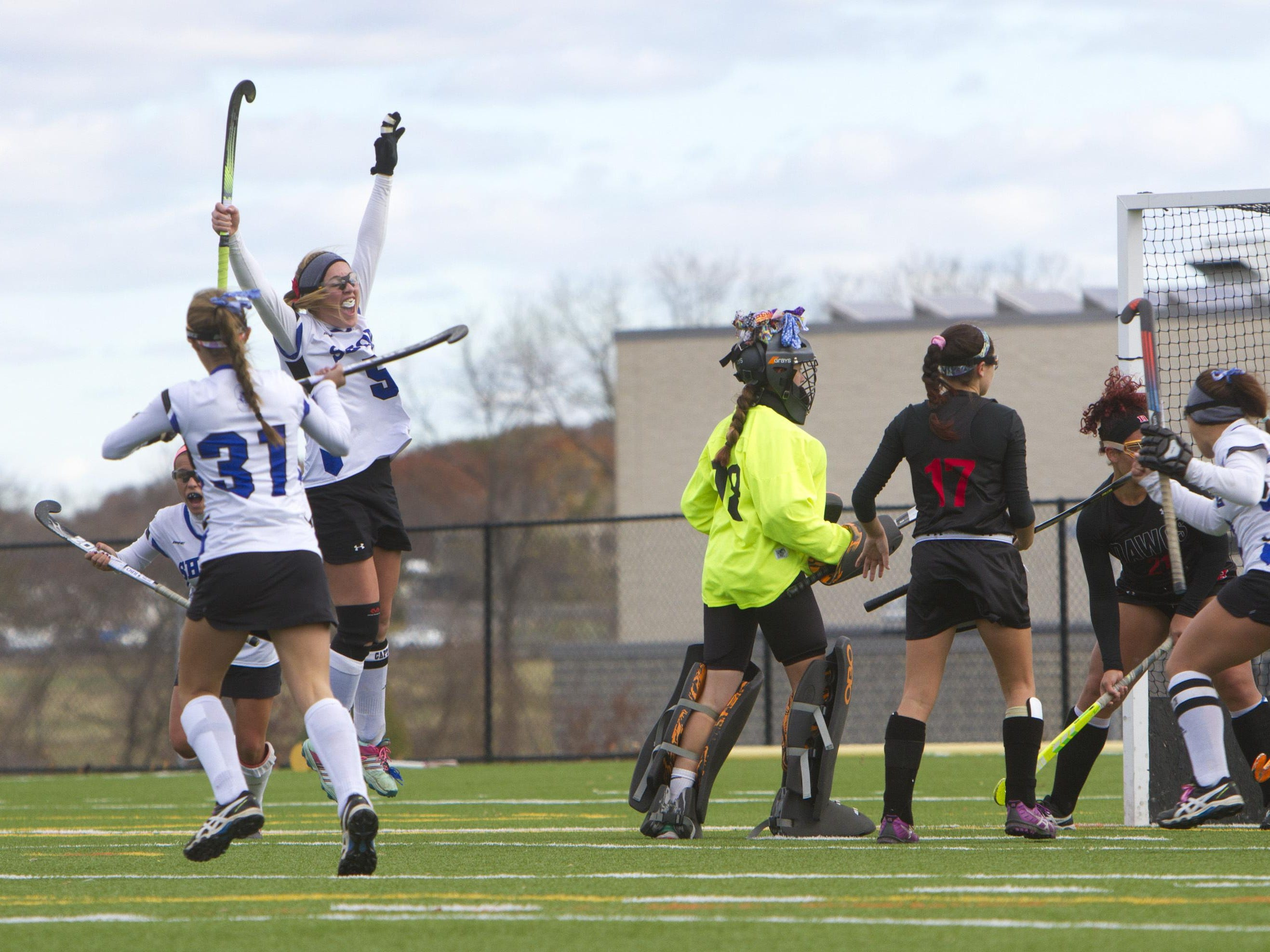 Shore Regional's Jessica Welch jumps in the air as she celebrates the first of her two goals against Haddonfield in Saturday's Group I final.