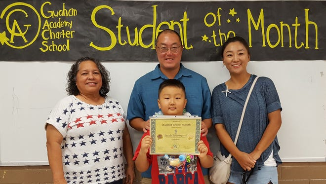The Guahan Academy Charter School honored its October Student of the Month awardees on Nov. 9. Pictured front row: Jacob Soderquist. Pictured from left back row: Mary Mafnas, Dean of Elementary School Guahan Academy Charter School; Mike Soderquist and Sujin Kim.