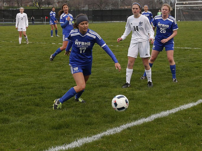 Whitefish Bay's Bailey Faulkner (17) attempts to get between Nicolet's Ashley Mehl (left) and Josie Kellerman (14) as teammate Sam Loya (25) looks on during the teams game at Nicolet High School Tuesday, April 26, 2016, in Glendale, Wisconsin.