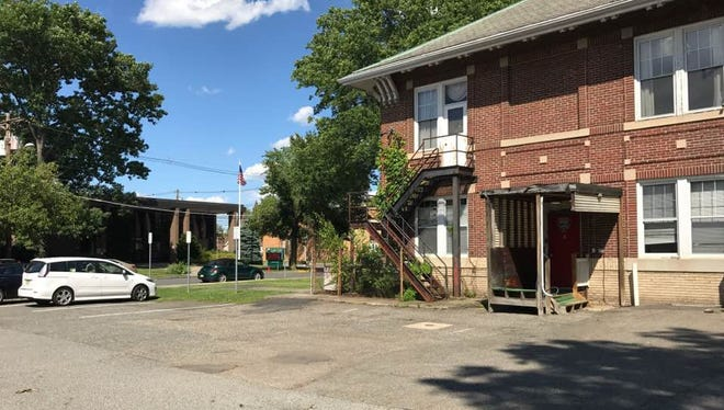 The Township of Little Falls is hopes to repave and restripe both the old police station lot, pictured, and the civic center lot in an effort to create more parking for patrons coming to town.