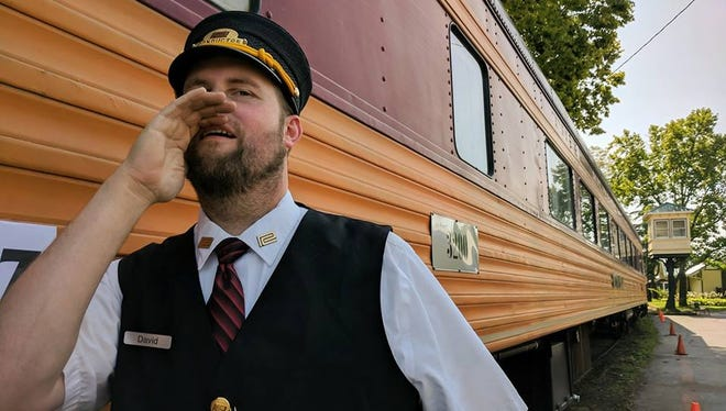 """The new Ohio Rail Experience in Lebanon is launching sightseeing train rides with vintage rail cars that will visit Madeira, Loveland, Reading and the Cincinnati riverfront. Here, passenger conductor David Rohdenburg of Amelia brushes up on his """"all aboarding"""" skills."""