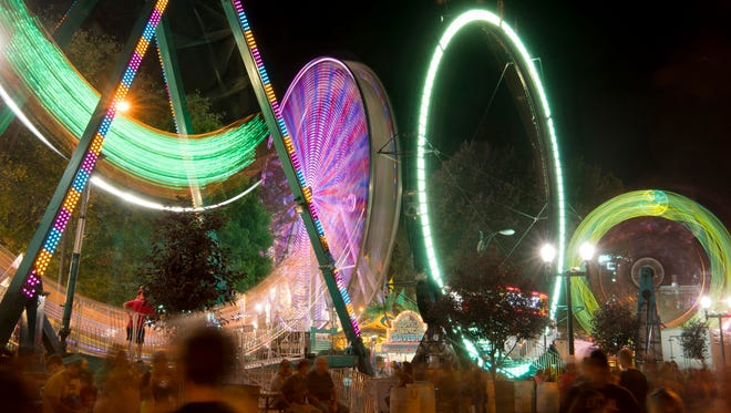 The rides created interesting blurs and patterns during a 15-second exposure at the West Side Nut Club Fall Festival Thursday evening.