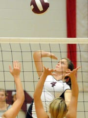 Stuarts Draft's Danielle Wilson attacks during a Shenandoah District match with Buffalo Gap on Thursday, Oct. 25, 2012.