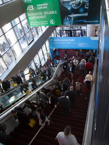 Attendees from around the world wander through the
