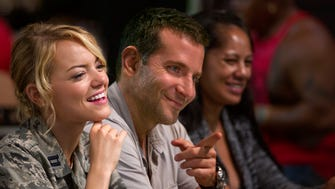 """Emma Stone, left, and Bradley Copper star in a scene from  Columbia Pictures' """"Aloha.""""  HANDOUT Photo by Neal Preston ORG XMIT: Bradley Cooper (Finalized);Emma Stone (Finalized) [Via MerlinFTP Drop]"""
