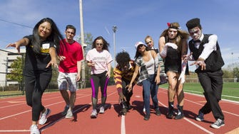 "From left, zombies Sabrina Araullo of East Brunswick, Matt Munzil of Whippany, Camryn Chernick of Ringwood, Justin Charles of Wyckoff, Hiral Patel of Passaic, Amanda Peacock of Williamstown, and Emily Clark and Tylir Brown of Hamilton crush the zombie walk at the Montclair State ""2K Walking Dead for Life"" event to benefit Hackensack's John Theurer Cancer Center."