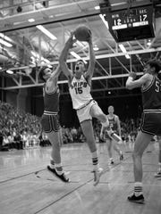 Manitowoc's Tom Haag drives to the basket during the Ships' sectional final victory over Neenah at JFK Fieldhouse. The Ships would go on to win the 1968 state championship.