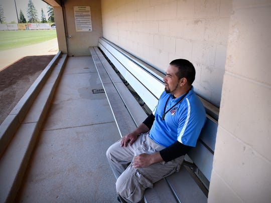 Augie Rodriguez sits on the bench in the home team dugout Friday at Joe Faber Field in St. Cloud. Rodriguez is returning for another season as manager of the St. Cloud Rox.