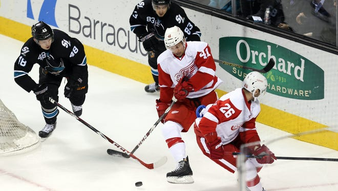 Detroit Red Wings right wing Luke Glendening (41) controls the puck ahead of San Jose Sharks center Tomas Hertl (48) during the first period at SAP Center at San Jose on Thursday, Feb. 26, 2015.