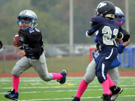 Canton Lions' junior freshman Evan Williams (No. 25)