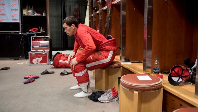 Pavel Datsyuk sits in his locker after the team photo was taken Monday.
