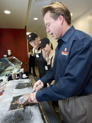 A photo of Lee Edward Knowlton at Cold Stone Creamery on Dec. 14, 2006, demonstrating how to mix an ice cream treat.