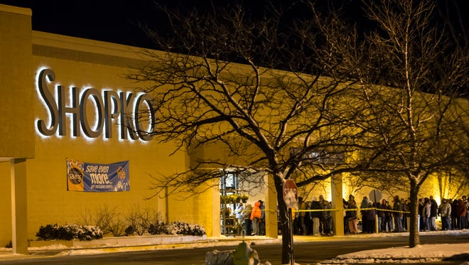 Shoppers stand in line outside in the cold waiting for Shopko to open their doors to early Black Friday deals Thanksgiving.