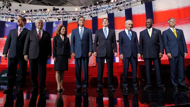 In this Sept. 7, 2011, file photo Republican presidential candidates stand together before a Republican presidential candidate debate at the Reagan Library in Simi Valley, Calif. Now Florida is about to get into the Republican presidential race big time, starting with a televised debate Monday, Sept. 12, in Tampa and ending with an early primary in 2012 that conceivably could wrap up the nomination.  From left are former Pennsylvania Sen. Rick Santorum, former House Speaker Newt Gingrich, Rep. Michele Bachmann, R-Minn., former Massachusetts Gov. Mitt Romney, Texas Gov. Rick Perry, Rep. Ron Paul, R-Texas, Businessman Herman Cain and former Utah Gov. Jon Huntsman.