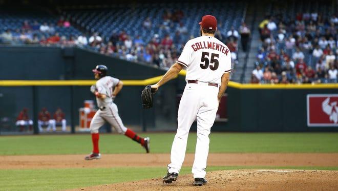 Arizona Diamondbacks pitcher Josh Collmenter watches Washington Nationals Ryan Zimmerman run the bases after hitting a 3-run home run in the 1st inning on Monday, May 11, 2015 Chase Field in Phoenix, AZ.