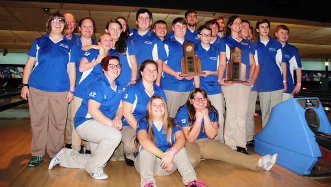 The Highlands bowling teams celebrate their region titles.
