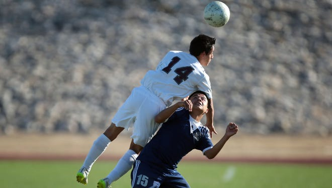 Rancho Mirage's Nathan Ocampo heads the ball during play with Lennox Academy on Wednesday, February 24, 2016.