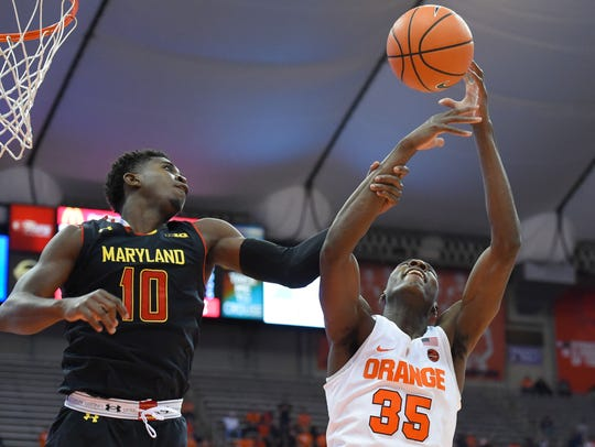 Maryland Terrapins guard Darryl Morsell (10) and Syracuse