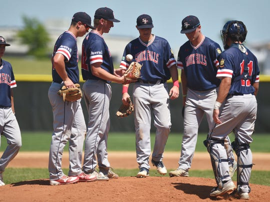 Post 15 West takes a time out during the game against Post 15 East in the first round of Region 2A playoffs Tuesday, July 24, at Harmodon Park in Sioux Falls.