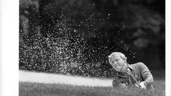 Arnold Palmer hits out of a sand trap on his way to bogeying No. 4 at Oak Hill during the second round of the 1984 U.S. Senior Open.