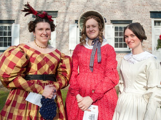 Dressed in period clothing are visitors from left: Robin Coccagna, Alice Wesson, both of Philadelphia, and Amanda Wood of Haddon Twp., NJ. Christmas at Allaire was held at The Historic Village at Allaire in Farmingdale, NJ, on Sunday, December 13, 2015.