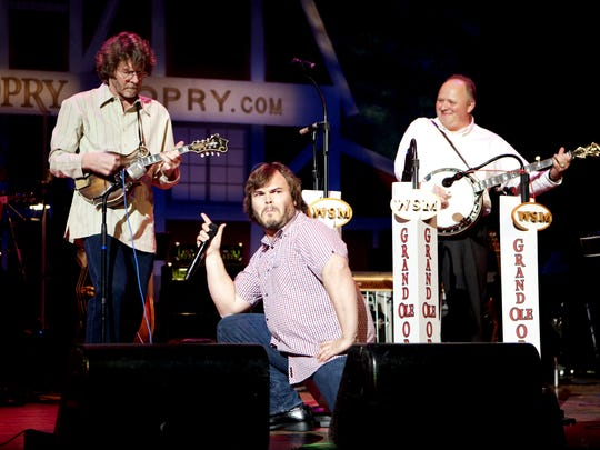 Actor Jack Black, middle, made his Grand Ole Opry debut Feb. 28, 2009, at the Ryman Auditorium.