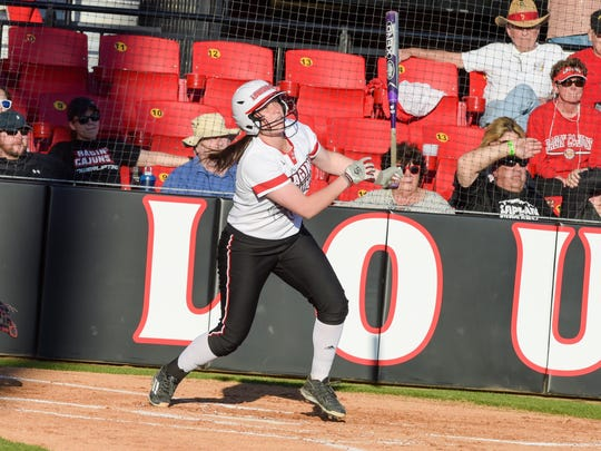 UL senior first baseman Kelsey Vincent smashes one of her five home runs during the Cajuns' win over Texas Tech.