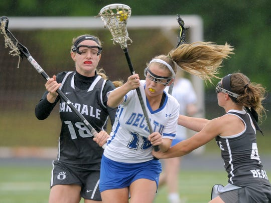 Stephen Decatur's Brigitte Ardis, center, tries to advance a ball past Oakdale's Paige Kolb, left, and Olivia Schwiegerath in the first half of a Class 3A/2A state semifinal girls lacrosse game Saturday, May 21, 2016, in Annapolis.