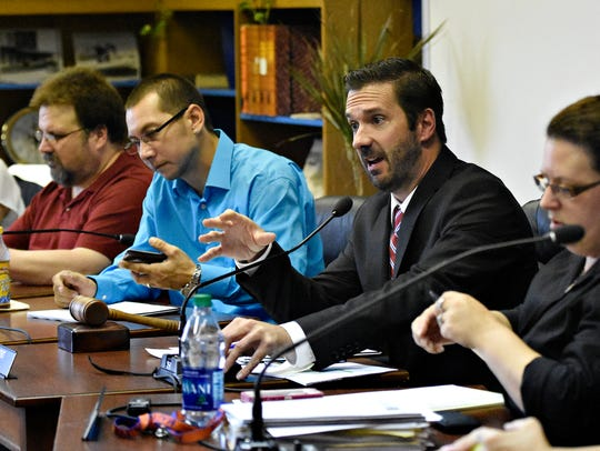 Councilman Shawn Mauck, center, speaks during the West