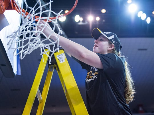 Troy's Kristen Emerson cuts down the net after the Trojans win the Sun Belt Conference tournament championship on March 12, 2017