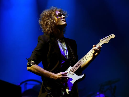 Musician Dave Keuning of The Killers performs onstage