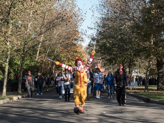 Ronald McDonald leads the march of students from all