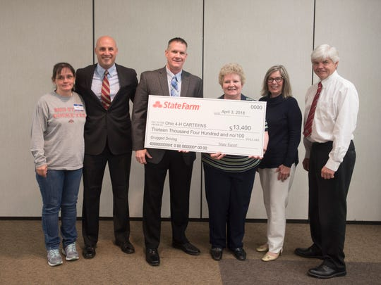 State Farm Insurance presents a check to Ohio 4-H CARTEENS to help with different programs with this year focusing on drunk driving and the purchase of items like  interactive goggles that simulate the effects of drunk driving. (L-R) Peggy Campbell, Ross County coordinator; Jeff Lehner, State Farm agent; Dave Strickland, State Farm agent; Judy Villard-Overocker, Ohio 4-H CARTEENS design team coordinator; Susie Natoli, State Farm agent; and Tom Archer, OH 4-H leader.