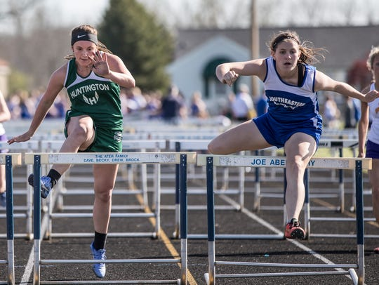 Southeastern's Maddie Allman, right glides over a hurdle