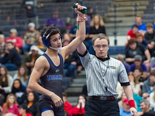 Teurlings Catholic's Mathew Carrier captures the 113-pound division to help the Rebels win the overall team title at the Ken Cole Invitational on Saturday.