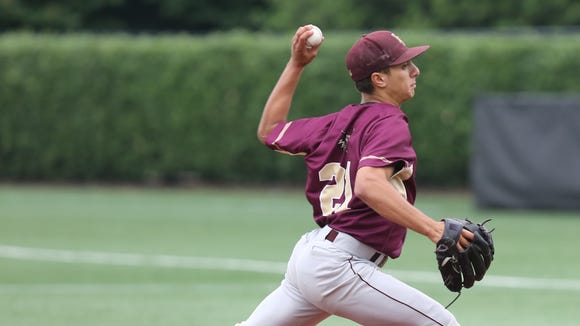 Iona Prep's Anthony Piccolino (21) pitches during CHSAA